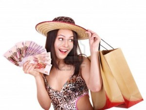 13259036-happy-woman-with-money-and-shopping-bag